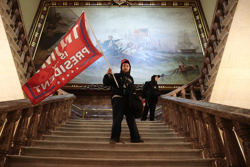 Rioters Incited by Trump Storm U.S. Capitol, Forcing Evacuation of Lawmakers as Woman Is Killed